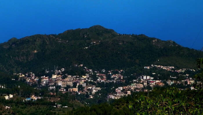 An aerial view of the city of Solan and the surrounding greenery